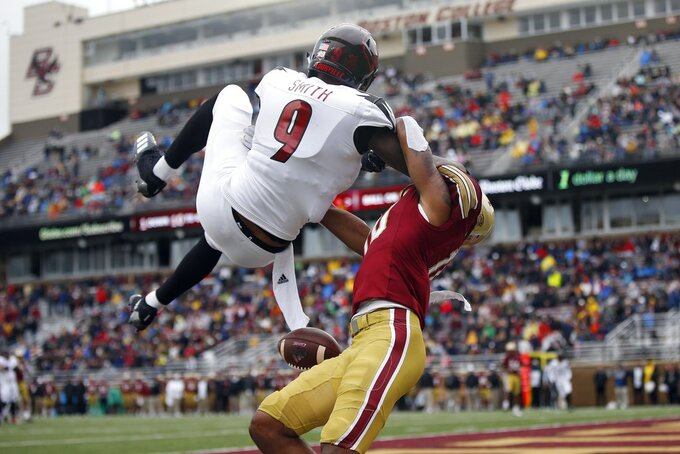 Boston College defensive back Brandon Sebastian, right, interferes with a pass intended for Louisville wide receiver Jaylen Smith (9) in the end zone during the first half of an NCAA college football game in Boston, Saturday, Oct. 13, 2018. (AP Photo/Michael Dwyer)