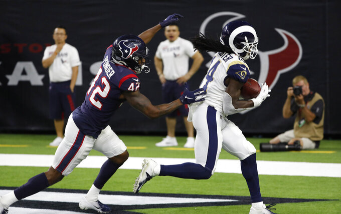 Los Angeles Rams wide receiver Nsimba Webster (14) catches a pass for a touchdown as Houston Texans defensive back Jermaine Ponder (42) defends during the second half of a preseason NFL football game Thursday, Aug. 29, 2019, in Houston. (AP Photo/Kevin M. Cox)