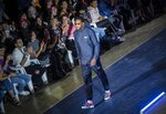 Cuban track and field legend Javier Sotomayor wears a creation from