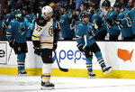 San Jose Sharks' Joe Pavelski (8) is congratulated after scoring a goal against the Boston Bruins during the second period of an NHL hockey game Monday, Feb. 18, 2019, in San Jose, Calif. (AP Photo/Ben Margot)