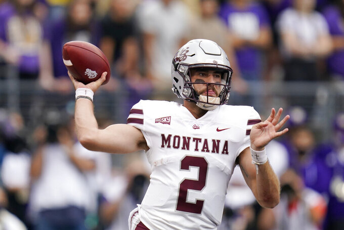 Montana quarterback Cam Humphrey drops back to pass against Washington in the first half of an NCAA college football game Saturday, Sept. 4, 2021, in Seattle. (AP Photo/Elaine Thompson)