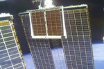 In this image taken from NASA video, a solar panel is unfolded at the International Space Station, Sunday, June 20 2021. (NASA via AP)