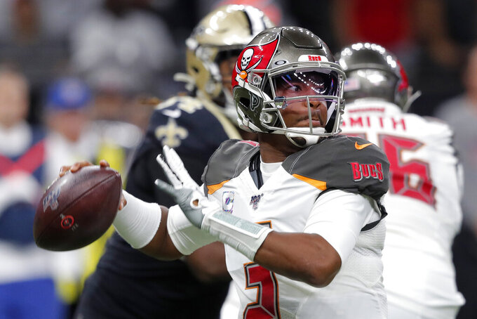 Tampa Bay Buccaneers quarterback Jameis Winston (3) passes in the first half of an NFL football game against the New Orleans Saints in New Orleans, Sunday, Oct. 6, 2019. (AP Photo/Bill Feig)