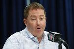FILE - In this Feb. 25, 2020, file photo, Detroit Lions executive vice president and general manager Bob Quinn speaks during a press conference at the NFL football scouting combine in Indianapolis. General managers around the league ran their drafts virtually without a hitch last month, thanks largely to the work and ingenuity of their information technology staffs. Tech support remains a vital role in the NFL offseason as long as team facilities are closed, with coaches and officials needing to connect with players scattered about the country.(AP Photo/Charlie Neibergall, File)
