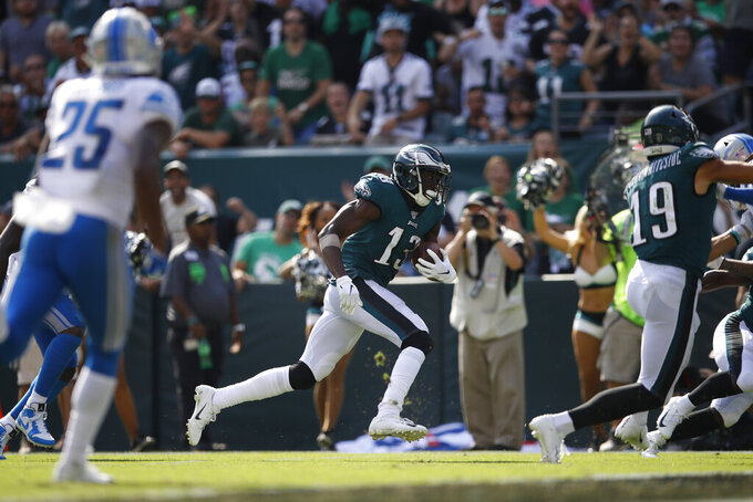 Philadelphia Eagles' Nelson Agholor (13) runs for a touchdown after a catch during the second half of an NFL football game against the Detroit Lions, Sunday, Sept. 22, 2019, in Philadelphia. (AP Photo/Matt Rourke)