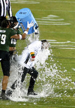 Hawaii coach Todd Graham gets doused after the team's 28-14 win over Houston in the New Mexico Bowl NCAA college football game in Frisco, Texas, Thursday, Dec. 24, 2020. (AP Photo/Matt Strasen)