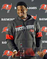 Tampa Bay Buccaneers quarterback Jameis Winston smiles during an NFL football press conference at Blackheath Rugby Football Club ground in London, Friday, Oct. 11, 2019. The Buccaneers face the Carolina Panthers in London on Sunday. (AP Photo/Kirsty Wigglesworth)