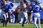 Georgia running back Kendall Milton (22) runs with the ball during the first half of an NCAA college football game against Kentucky, Saturday, Oct. 31, 2020, in Lexington, Ky. (AP Photo/Bryan Woolston)