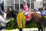 FILE - In this May 18, 2019, file photo, Tyler Gaffalione aboard War of Will poses for photos in the winners circle after winning the 144th Preakness Stakes horse race at Pimlico race course, in Baltimore. Gaffalione at 24 has become horse racing's rising star jockey after winning the Preakness and can add to his already impressive resume in the Belmont. (AP Photo/Steve Helber, File)
