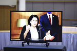 Georgian President Salome Zurabishvili speaks as she is video linked to a meeting room with European Council President Charles Michel at the European Council building in Brussels, Monday, April 19, 2021. (Kenzo Tribouillard, Pool via AP)