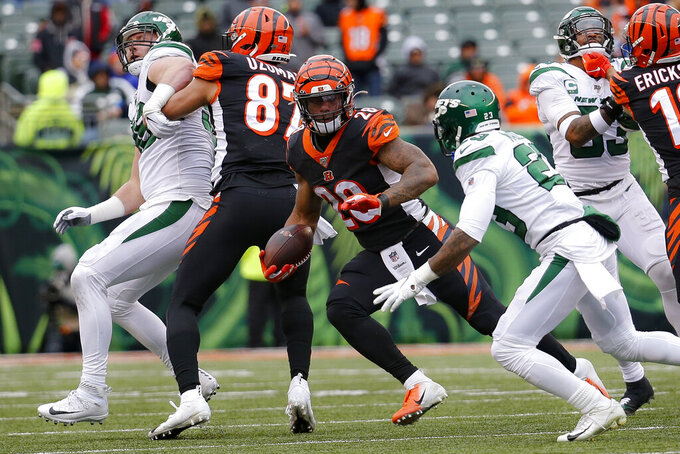 Cincinnati Bengals running back Joe Mixon (28) runs the ball against New York Jets cornerback Arthur Maulet (23) during the second half of an NFL football game, Sunday, Dec. 1, 2019, in Cincinnati. (AP Photo/Frank Victores)