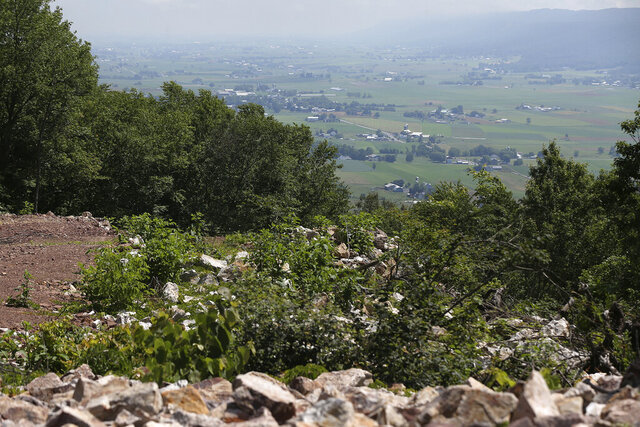 Farmland is pictured below Stone Mountain, where the Rural Broadband Cooperative's wireless internet tower is located in Mill Creek, Pa., on Tuesday, June 23, 2020. Local residents worked together to build and maintain the tower, which became operational in October 2019, because they were frustrated with slow internet service. (Tim Tai/The Philadelphia Inquirer via AP)