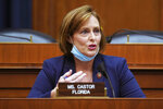 FILE - In this May 14, 2020 file photo Rep. Kathy Castor, D-Fla., speaks during House Energy and Commerce Subcommittee on Health hearing on Capitol Hill in Washington. House Democrats on Tuesday unveiled a plan to address climate change that would set a goal of net-zero greenhouse gas emissions by 2050, while pushing renewable energy such as wind and solar power and addressing environmental injustice that harms low-income and minority communities. (Greg Nash/Pool via AP)