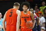Oregon State's Tres Tinkle (3) congratulates Ethan Thompson (5) after Thompson forced a turnover, as Arizona's Max Hazzard walks behind, in the closing minute of an NCAA college basketball game in Corvallis, Ore., Sunday, Jan. 12, 2020. (AP Photo/Chris Pietsch)