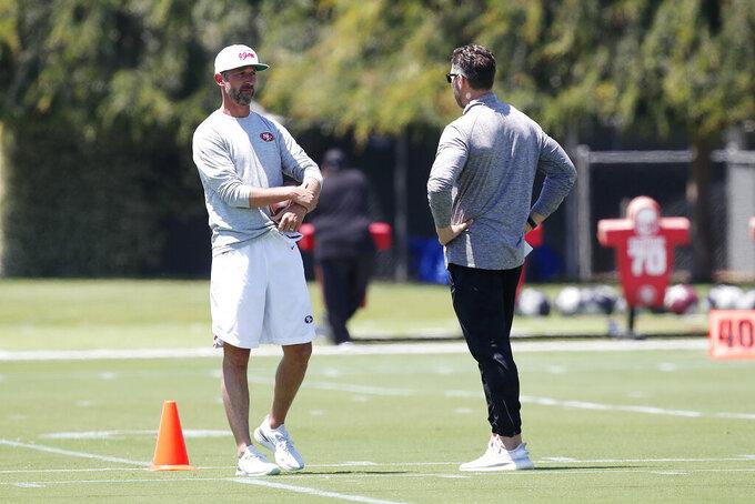 San Francisco 49ers head coach Kyle Shanahan watch players workout during NFL football practice in Santa Clara, Calif., Wednesday, June 2, 2021. (AP Photo/Josie Lepe)