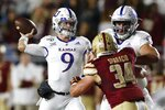 Kansas quarterback Carter Stanley (9) passes under pressure from Boston College linebacker Joseph Sparacio (34) during the first half of an NCAA college football game in Boston, Friday, Sept. 13, 2019. (AP Photo/Michael Dwyer)