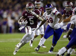 Texas A&M running back Trayveon Williams (5) runs away from Northwestern State nose tackle Damian Thompson (99) for a big gain during the first half of an NCAA college football game Thursday, Aug. 30, 2018, in College Station, Texas. (AP Photo/Sam Craft)