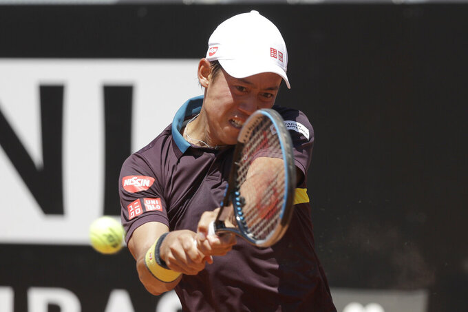 Japan's Kei Nishikori returns the ball to Italy's Fabio Fognini during their match at the Italian Open tennis tournament, in Rome, Monday, May 10, 2021. (AP Photo/Gregorio Borgia)