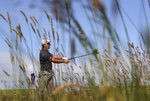United States' Bryson DeChambeau plays a shot on the 2nd fairway during the first round British Open Golf Championship at Royal St George's golf course Sandwich, England, Thursday, July 15, 2021. (AP Photo/Ian Walton)