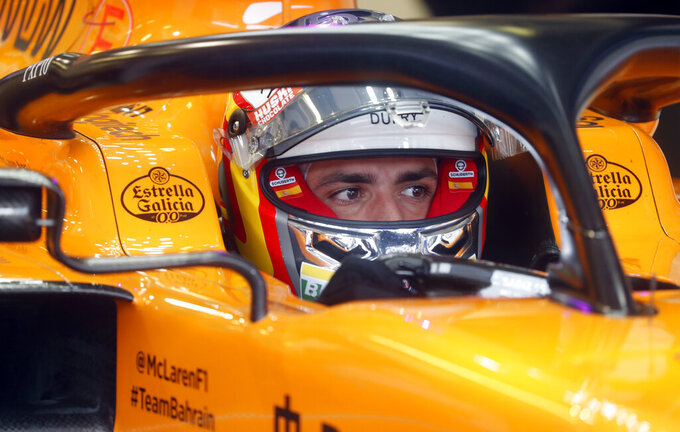 Mclaren driver Carlos Sainz of Spain prepares for the second practice session of the Hungarian Formula One Grand Prix at the Hungaroring racetrack in Mogyorod, northeast of Budapest, Hungary, Friday, Aug. 2, 2019. The Hungarian Formula One Grand Prix takes place on Sunday. (AP Photo/Laszlo Balogh)