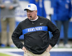 FILE - In this Nov. 17, 2018, file photo, Kentucky head coach Mark Stoops looks on before an NCAA college football game against Middle Tennessee, in Lexington, Ky.  Stoops knows that duplicating last season's success is asking a lot. After all, the Wildcats won 10 games for the first time since 1977 _ including a victory in the Citrus Bowl, which was their first postseason win since 2008. Career performances from defensive standout Josh Allen and running back Benny Snell helped make it possible, but they've departed along with many significant contributors. (AP Photo/Bryan Woolston, File)