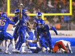 Boise State cornerback Avery Williams (26) celebrates recovering a fumble by Fresno State wide receiver Michiah Quick during an NCAA college football game for the Mountain West Conference championship Saturday, Dec. 1, 2018, in Boise, Idaho. (Darin Oswald/Idaho Statesman via AP)