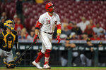 Cincinnati Reds' Joey Votto (19) watches his solo home run during the fifth inning of a baseball game against the Pittsburgh Pirates in Cincinnati, Monday, Sept. 20, 2021. (AP Photo/Aaron Doster)