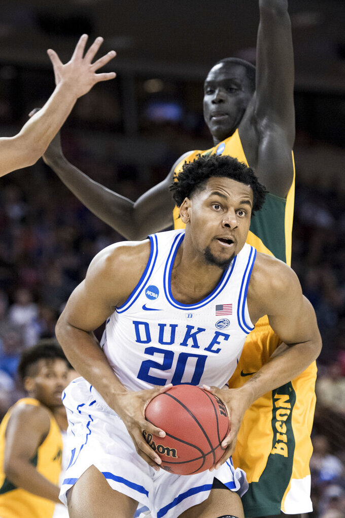 Duke center Marques Bolden (20) drives to the basket against North Dakota State forward Deng Geu during the first half of a first-round game in the NCAA men's college basketball tournament Friday, March 22, 2019, in Columbia, S.C. (AP Photo/Sean Rayford)