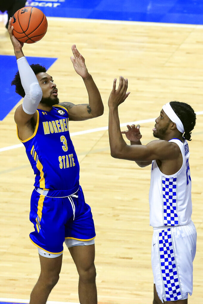 Morehead State's James Baker, left, shoots next to Kentucky's Isaiah Jackson during the first half of an NCAA college basketball game in Lexington, Ky., Wednesday, Nov. 25, 2020. (AP Photo/James Crisp)