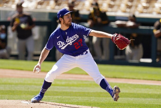Los Angeles Dodgers starting pitcher Trevor Bauer throws against the San Diego Padres during the first inning of a spring training baseball game Saturday, March 6, 2021, in Phoenix. (AP Photo/Ross D. Franklin)