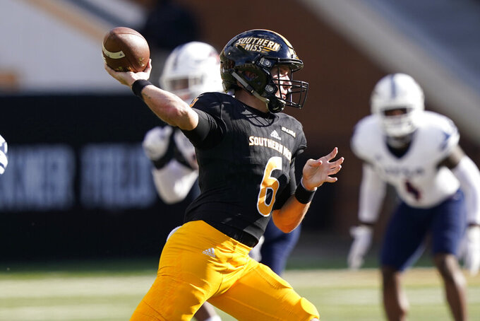 Southern Mississippi quarterback Tate Whatley (6) throws a pass against UTSA during the first half of an NCAA college football game, Saturday, Nov. 21, 2020, in Hattiesburg, Miss. (AP Photo/Rogelio V. Solis)