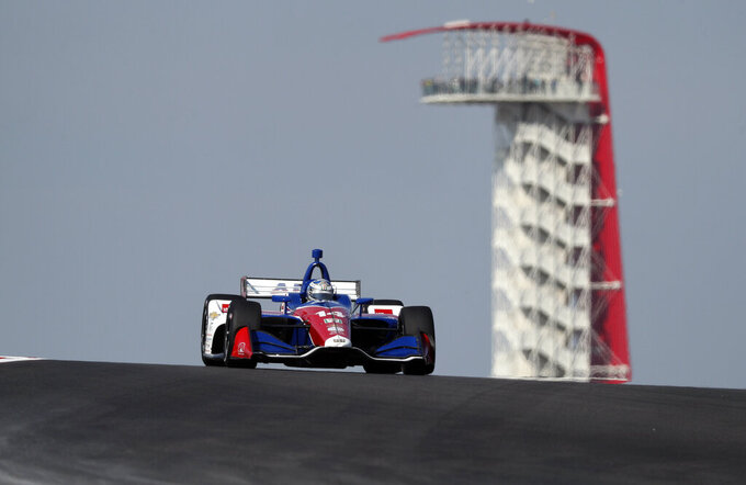 A.J. Foyt Enterprises driver Tony Kanaan (14), of Brazil, steers through a turn during a practice session for the IndyCar Classic auto race, Friday, March 22, 2019, in Austin, Texas. (AP Photo/Eric Gay)
