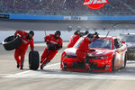 The pit crew for Justin Allgaier (7) scramble around the race car to change tires during a pit stop in a NASCAR Xfinity Series auto race at Phoenix Raceway, Saturday, Nov. 7, 2020, in Avondale, Ariz. (AP Photo/Ralph Freso)