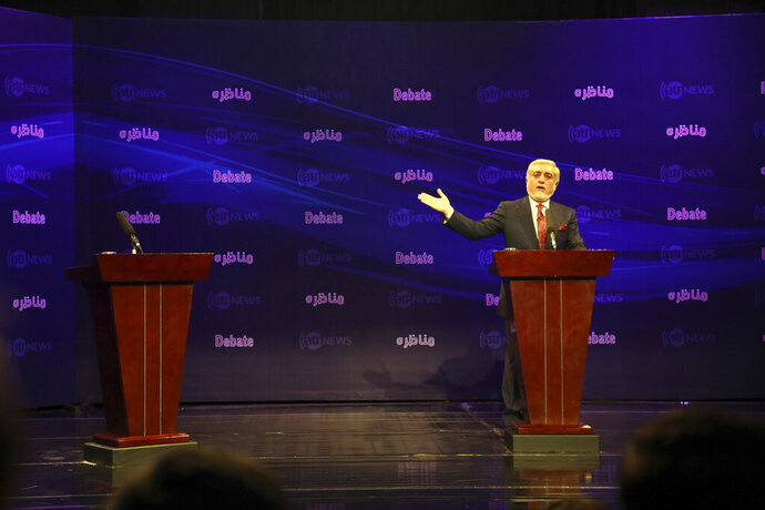 Afghanistan presidential candidate Abdullah Abdullah speaks during the first presidential election debate at the Ariana TV building, a private TV station, in Kabul, Afghanistan, Monday, Sept. 16, 2019. Afghan president Ashraf Ghani cancelled his first electoral debate with his main electoral rival, Abdullah Abdullah, the country's chief executive. Both men are partners in the national unity government. (AP Photo/Rahmat Gul)