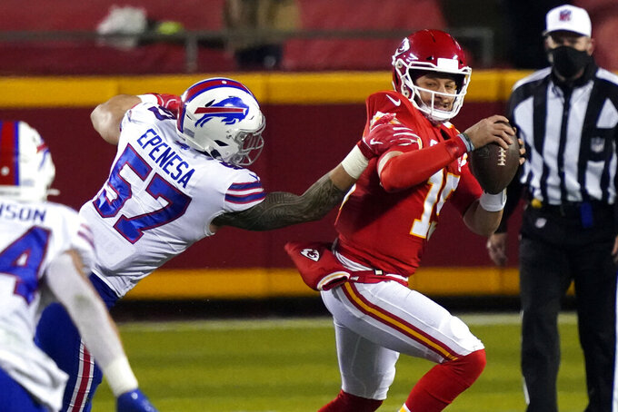 Kansas City Chiefs quarterback Patrick Mahomes is pressured by Buffalo Bills defensive end AJ Epenesa (57) during the first half of the AFC championship NFL football game, Sunday, Jan. 24, 2021, in Kansas City, Mo. (AP Photo/Jeff Roberson)