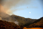 An air tanker prepares to drop retardant on the Windy Fire burning on Tule River Reservation in California on Thursday, Sept. 16, 2021. The fire has burned into the Peyrone Sequoia Grove and continues to threaten other sequoias according to fire officials. (AP Photo/Noah Berger)
