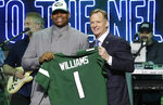 Alabama defensive tackle Quinnen Williams poses with NFL Commissioner Roger Goodell after the New York Jets selected Williams in the first round at the NFL football draft, Thursday, April 25, 2019, in Nashville, Tenn.(AP Photo/Steve Helber)