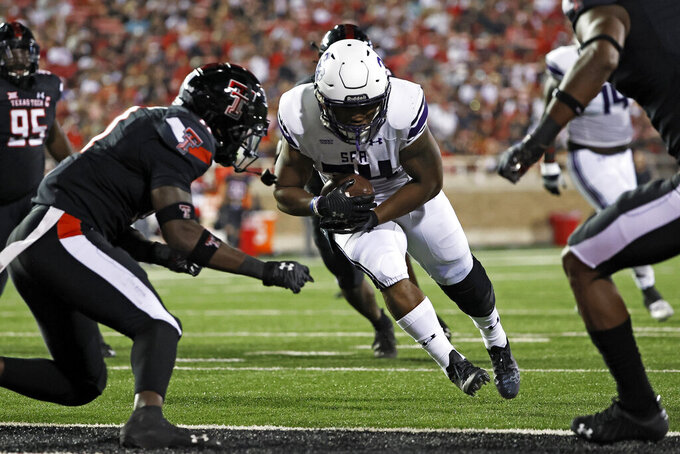 Stephen F. Austin's Ja'Bray Young (34) scores a touchdown during the second half of the team's NCAA college football game against Texas Tech, Saturday, Sept. 11, 2021, in Lubbock, Texas. (AP Photo/Brad Tollefson)