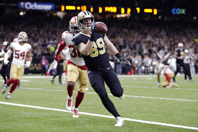 New Orleans Saints tight end Josh Hill (89) carries on a touchdown reception in front of San Francisco 49ers defensive back Marcell Harris (36) in the first half an NFL football game in New Orleans, Sunday, Dec. 8, 2019. (AP Photo/Brett Duke)