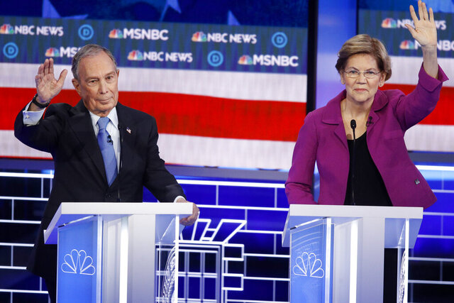 Democratic presidential candidates, former New York City Mayor Mike Bloomberg, left, and Sen. Elizabeth Warren, D-Mass., try to answer a question during a Democratic presidential primary debate Wednesday, Feb. 19, 2020, in Las Vegas, hosted by NBC News and MSNBC. (AP Photo/John Locher)