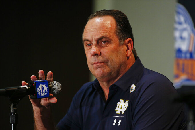Notre Dame coach Mike Brey answers a question during the Atlantic Coast Conference NCAA college basketball media day in Charlotte, N.C., Tuesday, Oct. 8, 2019. (AP Photo/Nell Redmond)