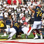 West Virginia's Leddie Brown scores a touchdown against Maryland during the first half of an NCAA college football game Saturday, Sept. 4, 2021 in College Park, Md. (Kevin Richardson/The Baltimore Sun via AP)