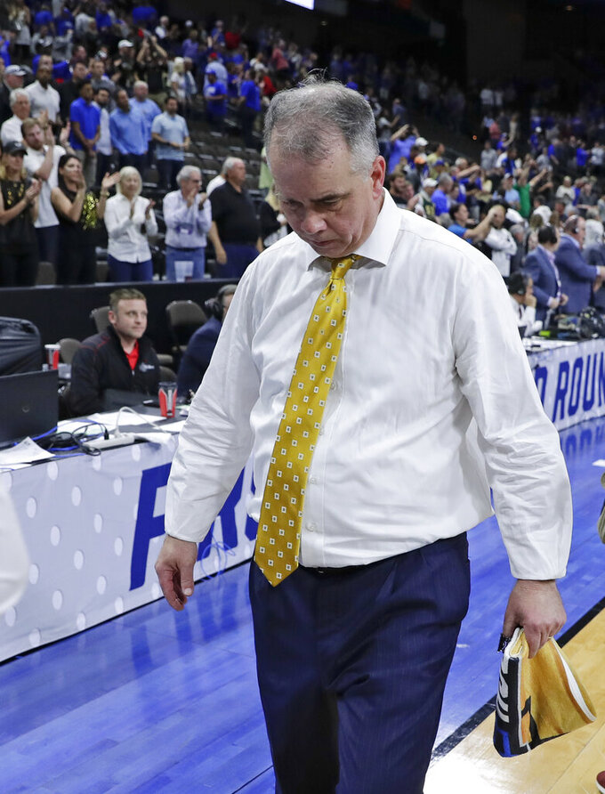 Wofford head coach Mike Young walks off the court after losing to Kentucky in a second-round game in the NCAA men's college basketball tournament in Jacksonville, Fla., Saturday, March 23, 2019. (AP Photo/John Raoux)