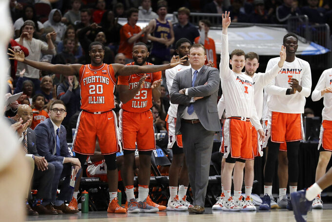 Illinois bench react to a 3-point shot during the first half of an NCAA college basketball game against the Iowa in the second round of the Big Ten Conference tournament, Thursday, March 14, 2019, in Chicago. (AP Photo/Nam Y. Huh)