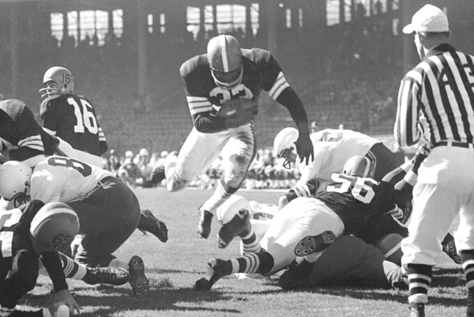 FILE - In this Oct. 12, 1958, file photo, Cleveland Browns fullback Jim Brown runs against the Chicago Cardinals for a touchdown in the first half of a football game in Cleveland. Brown scored three touchdowns in Cleveland's 35-28 win. Brown led the NFL in rushing eight times and was league MVP three times; finished with more than 12,000 yards rushing and 106 rushing touchdowns; and averaged 5.2 yards per carry. And he did all this in only nine seasons before retiring at age 30 to become an actor. (AP Photo/File)