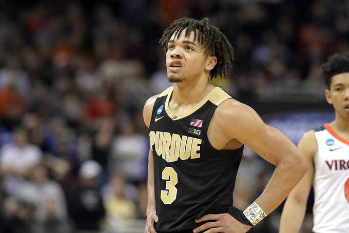 Purdue's Carsen Edwards looks up at the scoreboard during overtime of the men's NCAA Tournament college basketball South Regional final game against Virginia, Saturday against Virginia, March 30, 2019, in Louisville, Ky. Virginia won 80-75. (AP Photo/Timothy D. Easley)