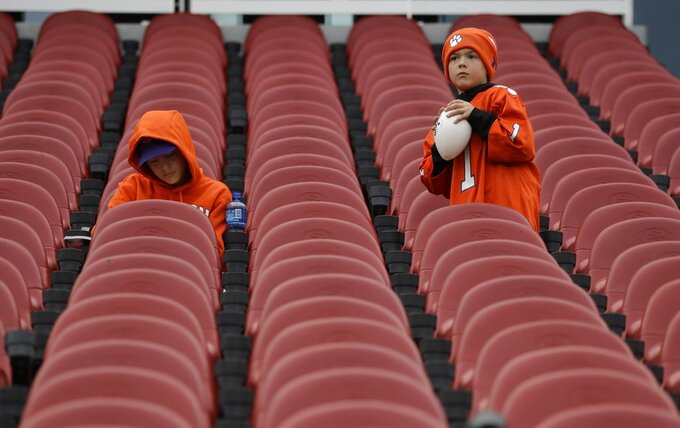 Fans wait for the start of the NCAA college football playoff championship game between Alabama and Clemson Monday, Jan. 7, 2019, in Santa Clara, Calif. (AP Photo/Chris Carlson)