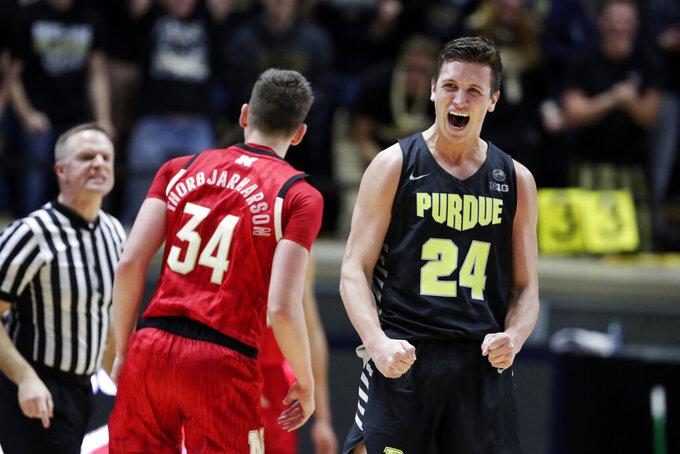 Purdue forward Grady Eifert (24) celebrates a 3-point basket against Nebraska during the second half of an NCAA college basketball game in West Lafayette, Ind., Saturday, Feb. 9, 2019. (AP Photo/Michael Conroy)