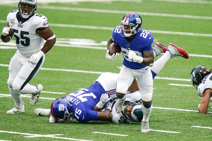 New York Giants' Wayne Gallman (22) rushes during the first half of an NFL football game against the Philadelphia Eagles, Sunday, Nov. 15, 2020, in East Rutherford, N.J. (AP Photo/Seth Wenig)