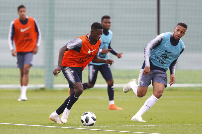 France's Ousmane Dembele dribbles the ball during a training session at the 2018 soccer World Cup in Glebovets, Russia, Tuesday, June 12, 2018. (AP Photo/David Vincent)
